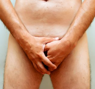 naked man covering his junk, potency issue