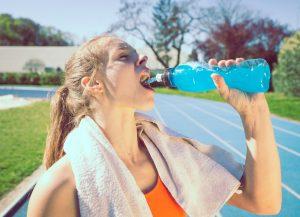 runner drinking sports drink
