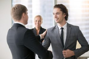 successful man congratulated by boss