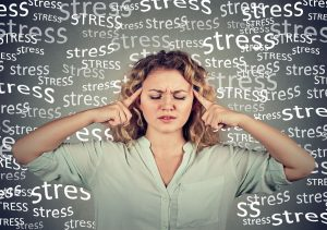 stressed woman trying to clear head and think