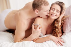 couple in bed, whispering dirty talk