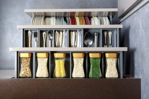 top view of organized and categorized kitchen drawer, spices, cutlery