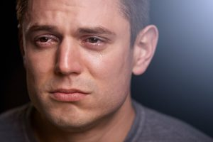 depressed man crying alone