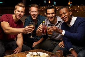 men drinking in bar during guys night out