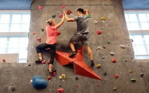 couple on a rock climbing date man happier