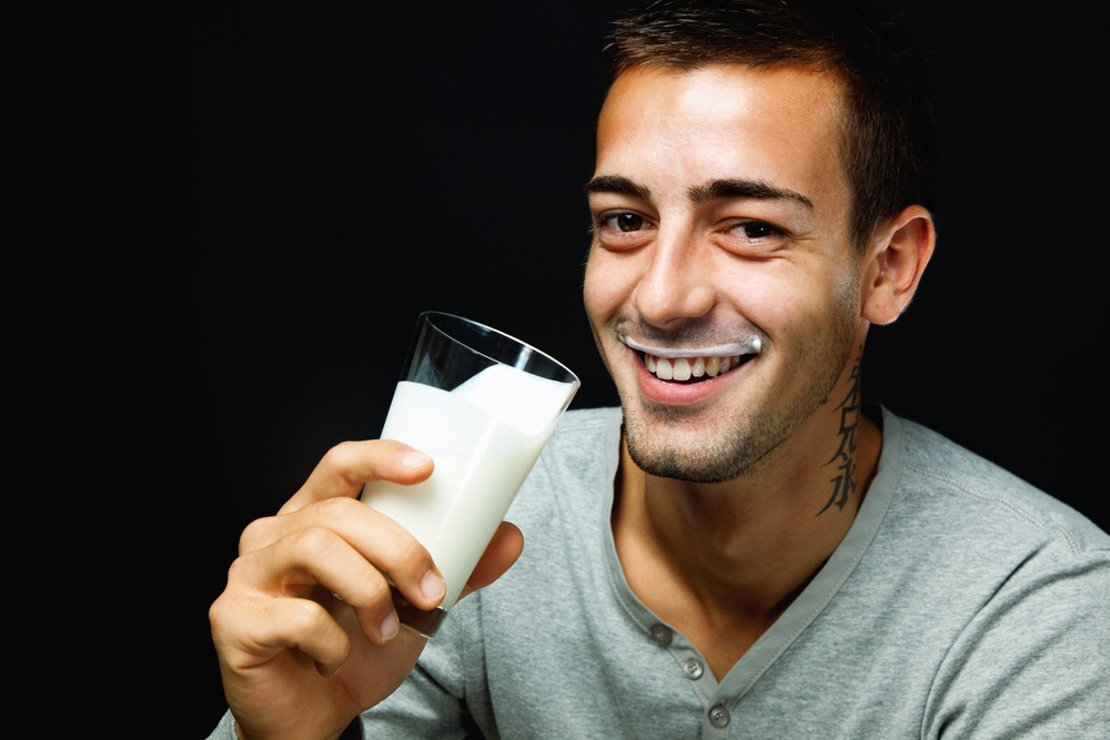 man who uses Progentra drinks milk with mustache