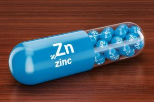 man takes zinc supplement