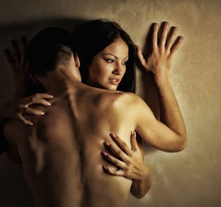 couple making love standing against the wall man has been using Progentra for a while