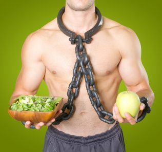 man with orthorexia in chains slave to healthy food fixation