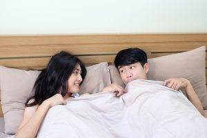 shy couple under the blanket